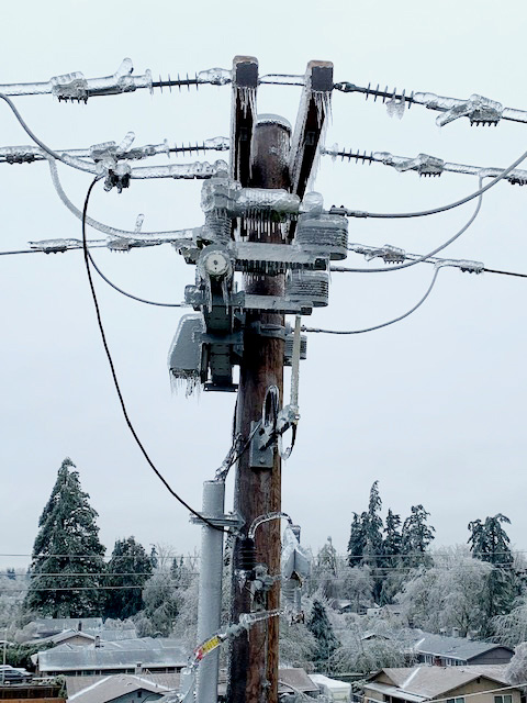 Power pole and transformer covered in ice