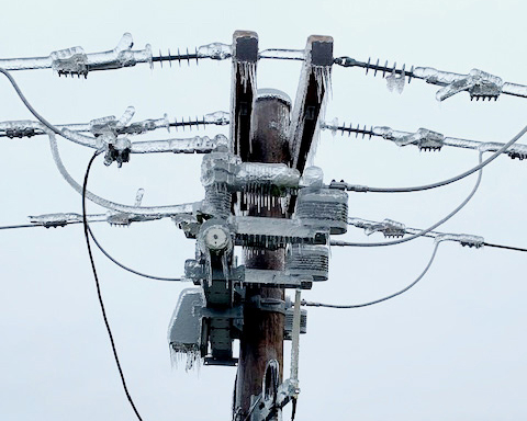 Icy power pole and transformer